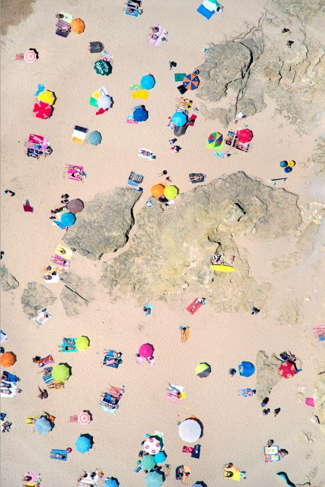 Umbrellas on the beach make a stunning summer pattern.