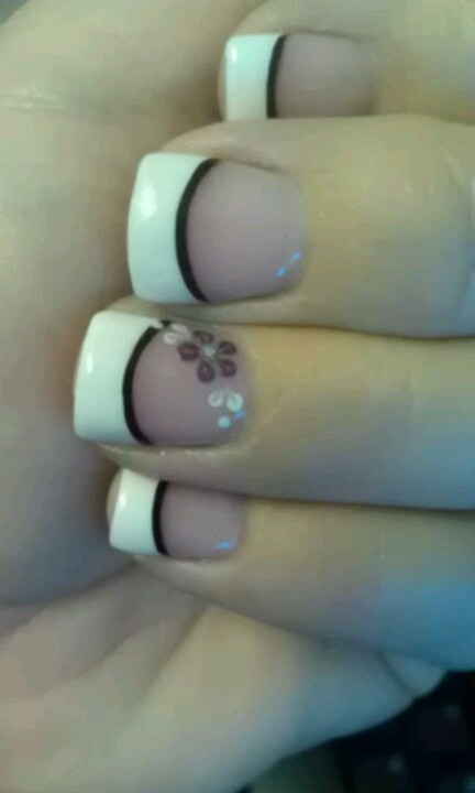 French tips with black line and purple flowers on ring finger