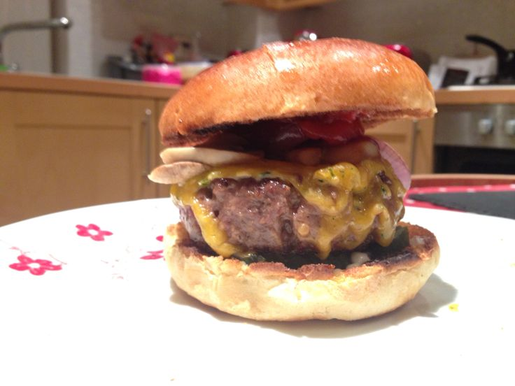 Wagyu Beef Burger with melted Double Gloucester cheese (with onion & chive) with sautéed red onion and mushrooms served in a toasted brioche bun (All from Aldi) and some Heinz Ketchup and Hellman's Mayo.
