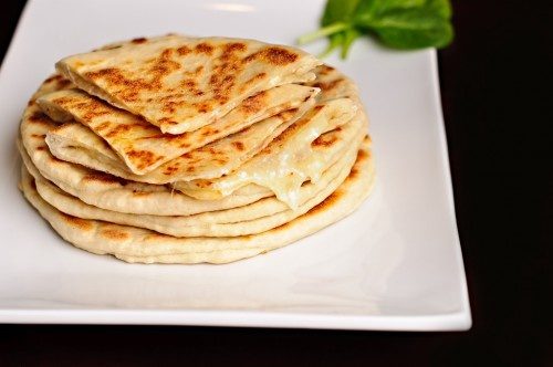 Pan Grilled Khachapuri: Khachapuri is a Georgian appetizer, which consists of a dough and a springy cheese filling.