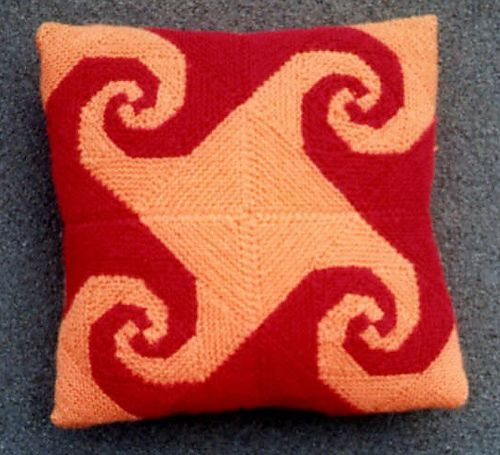 Best of Both Whirls - Modular knit cushion, made from baravelle spirals, with smaller modules on the back  (In Cushy Numbers)