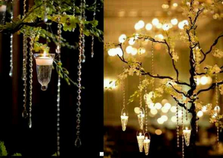 Wedding decor. Trees adorned with candles and crystals.!!