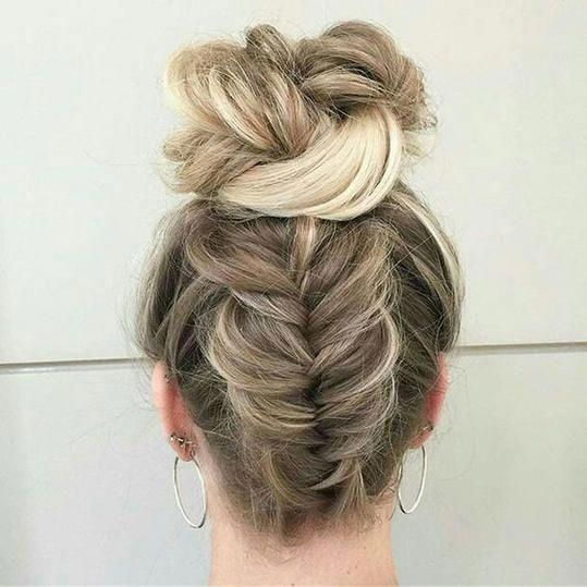 Upside Down Braid Bun   Transform your natural curls with these gorgeous buns, ponytails, and braids. Curly hair, though packed with life and personal...