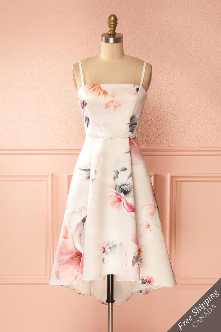 Joberthe #boutique1861 / Become an elegant messenger of springtime happiness thanks to this striking floral dress. The full and light skirt falls higher in the front, creating an asymmetrical effect. The bustier will stay in place thanks to the adhesive band, boning, and thin removable straps.