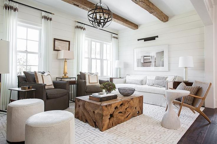 Rustic Wood Beams Hang Over A Living Room Boasting A White
