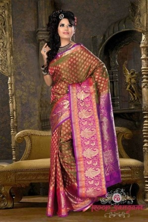 This elegant two shaded dhoop chaon Kanchivaram saree is perfect for an occasion when you want to create a style statement wherever you go.