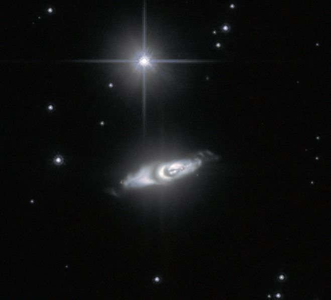 - * IRAS 22036 + 5306 * - Only 6,500 light-years away in the constellation Cepheus, a dying star absorbed its companion during its expansion stage. This interaction probably caused the dark dust ring. The star's poles are ejecting twin jets which are hurtling outward at more than 372,822 mph (600,000 kph). The cast off material encircling the star could be the remnants of comets and other small rocky bodies -