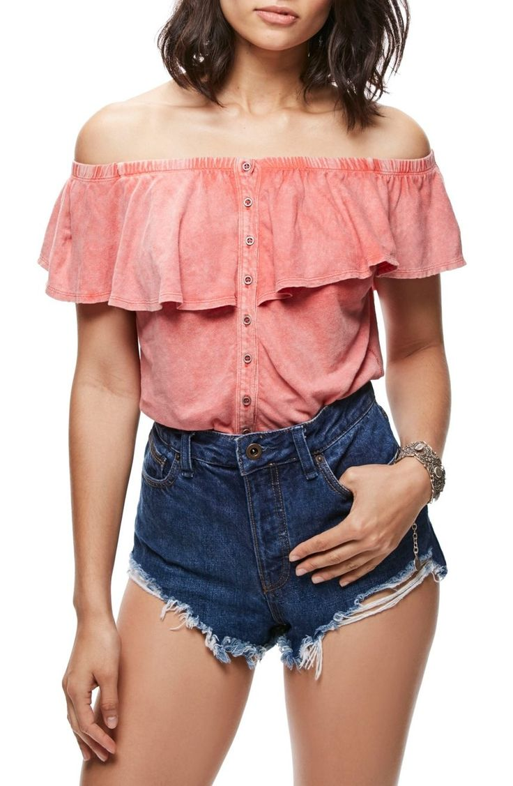 Perfect for sun-soaked afternoons, this flirty knit top has a ruffled neckline that shows off the shoulders.
