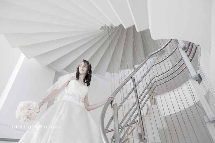Bride portrait. Beautiful circular staircases at the hotel. Gown by Eve of Milady - style 4300. Rose bouquet by Sonia Speranza. Argentina destination wedding at Del Bono Park Hotel, San Juan. Wedding Photographer | Gerard Tomko.