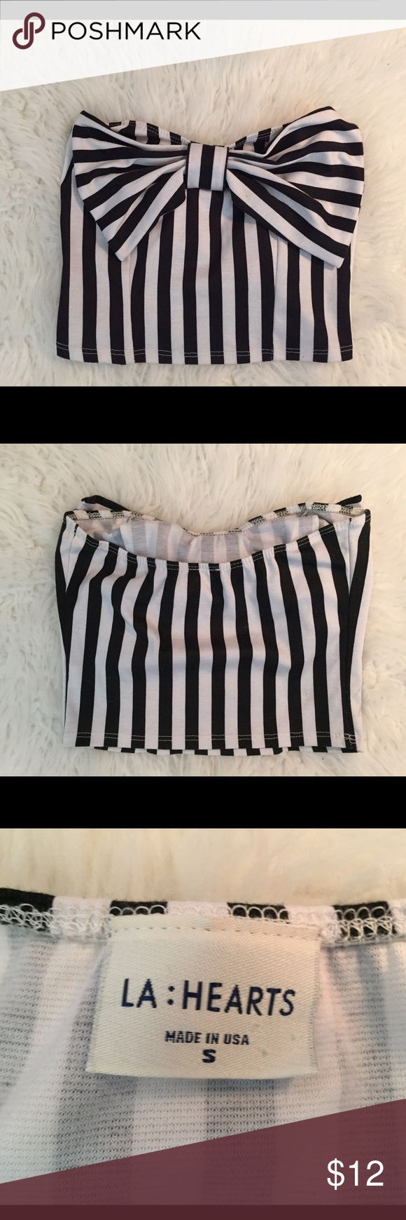 Black and White Striped Crop Top with Bow Crop Top from Forever 21- black and white stripes with a big bow on the front over the chest area. It's a half-shirt so it's a little shorter than a normal crop top. Very comfy though! LA Hearts Tops Crop Tops