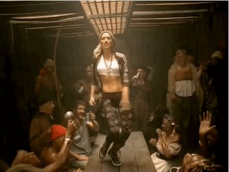 """Her beanie-cut-off-tank-track-jacket-argyle-legging-with-leather-belt-without-belt-loops look in """"Rich Girl"""". 