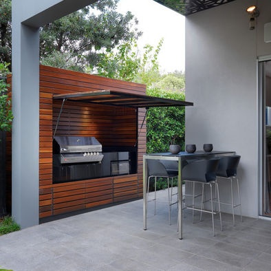 Dual function.  Hides BBQ area when not in use and acts as a cover from sun and rain when in use. Great design.