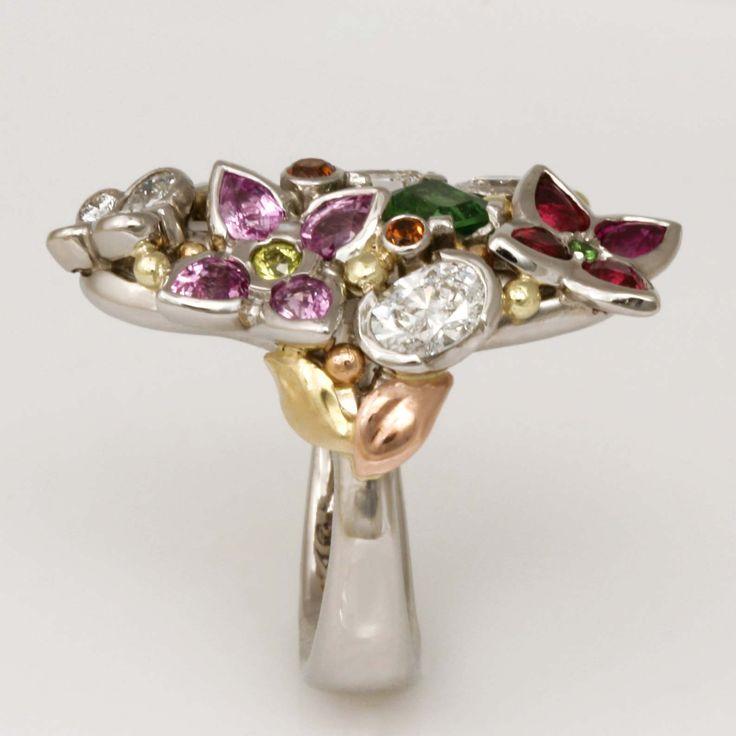 www.robertpaul.com.au Ladies handmade palladium, green gold and rose gold ring featuring diamonds, rubies, pink sapphires, spessartite garnets, tsavorite garnets and chrysoberyl.