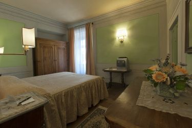 One oif the beautiful bedroom of Villa Narcisa in Lucca, Tuscany.