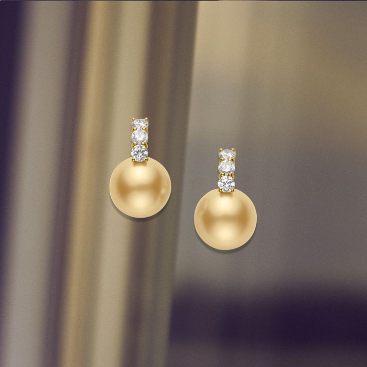 These #Mikimoto Classic Golden South Sea earrings feature 13mm opulent pearls, adorned with 1.01ct diamonds and set in 18K yellow gold. #PearlMonth #MikimotoPearlMonth