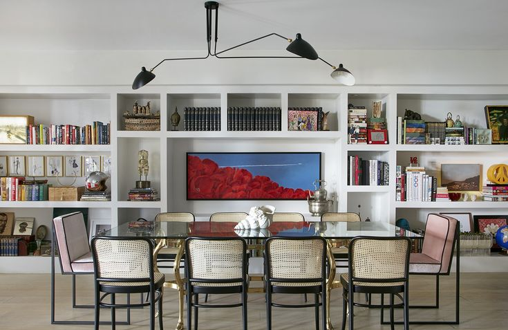 What's not to love about the combination of a dining area and books in one room? A perfect example of style and function at work, these 16 dining rooms that are complete with libraries are sure to be a source of inspiration for your next project (and your next great read).