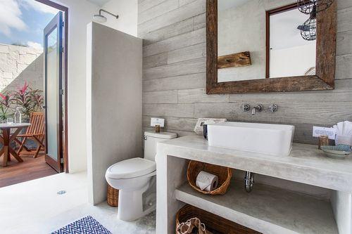 Mosaicos artesanales, madera de Tzalam, piedra y hormigón son los materiales del hotel Sanará Tulum, situado en la Riviera Maya. Es además un centro de sanación y bienestar en México.