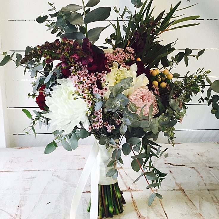 Autumn Flowers  Leafy Eucalyptus and peppercorn foliages with pops of colour from Snap Dragons…