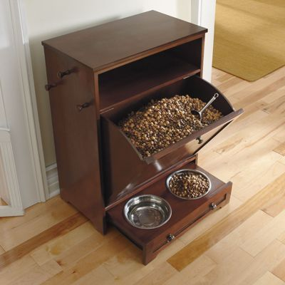 "Pet Feeder Station: 24""W x 14""D x 32""H, 40 lbs. Inner Top Shelf: 22""W x 13-1/2""D x 6""H. Food Storage Area: 20-1/2""W x 12"" Top, 7"" base x 16""H. Pet Feeder Opening: 9"" out, Two 2-qt. bowls."