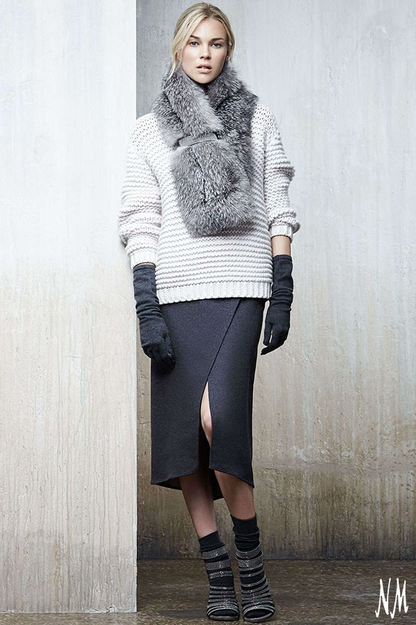 A layered look adds warmth and style. Top this Brunello Cucinelli wool cashmere faux-wrap skirt with a chunky knit and luxe fur scarf for chic comfort.