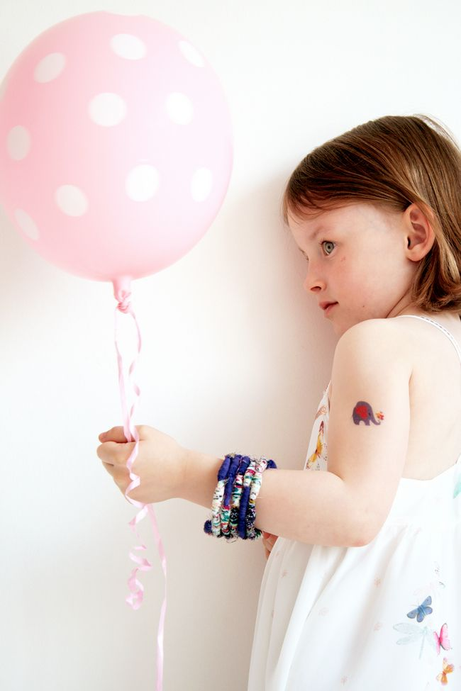 DIY: Fabric Bead Bracelet Tutorial | http://hellonatural.co/kid-craft-fabric-bead-bracelet-tutorial/