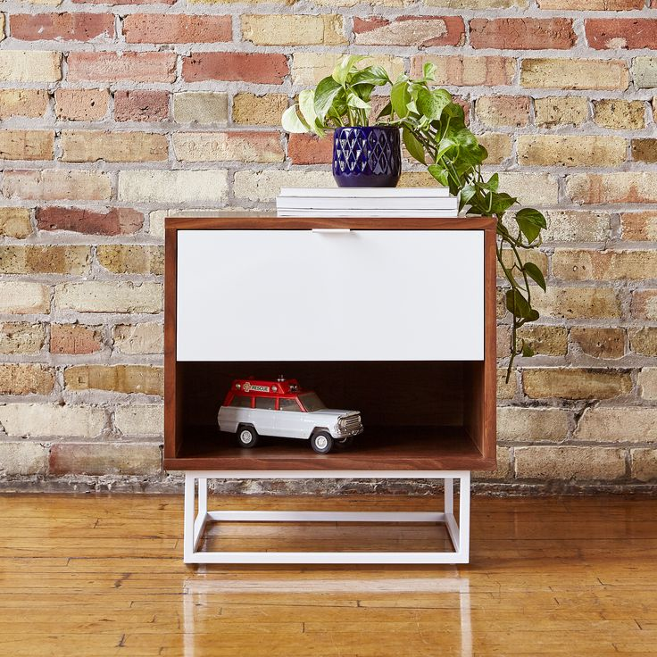 Emerson End Table | The Emerson End Table is a minimalist design that contrasts wood grain with smooth lacquer surfaces, creating a piece that is both timeless and contemporary. | Gus* Modern