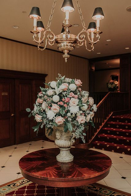 Elegant decor in the lobby to greet the guests for Ashley and Patrick's wedding at DuPont Country Club. Kelli Wilke Photography.
