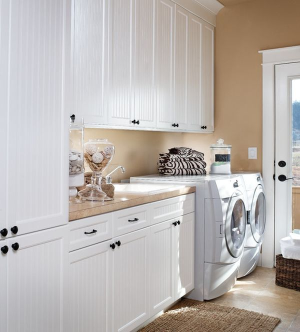 Most often, people choose white as a primary color for the laundry room's décor