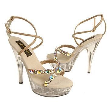 You'll look out of this world in the sultry Johnathan Kayne Juno platform sandals. Faux leather upper in a dress platform sandal style with a round open toe. Glorious Swarovski Austrian crystal embellishments adorn the crisscross vamp straps, crisscross instep straps features an adjustable buckle closure.