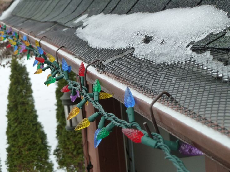 A Close Up Using Out Brown Christmas Hooks For Gutters