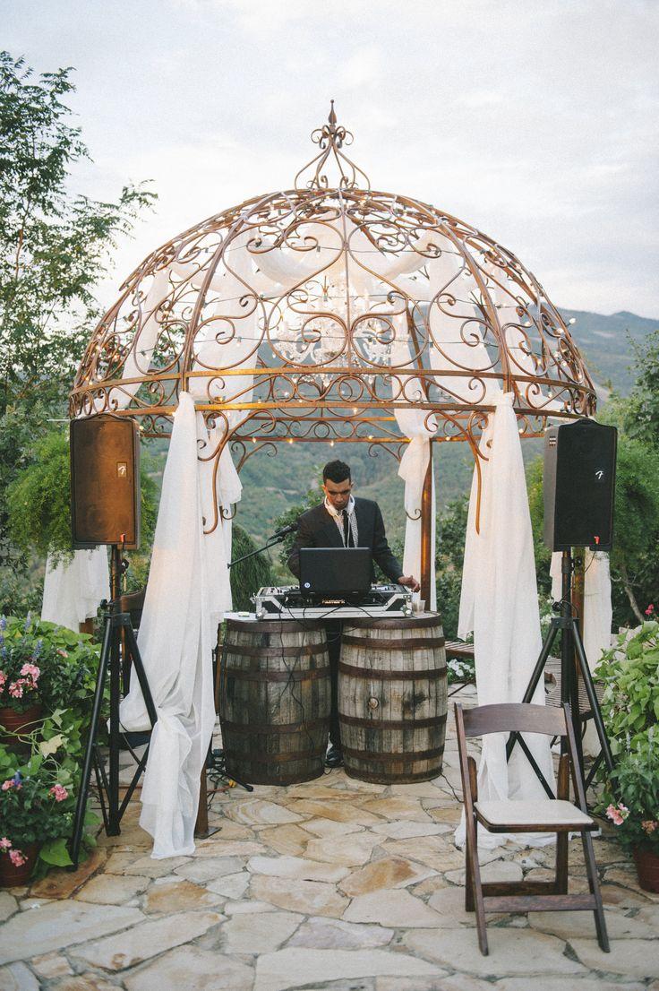 Rustic DJ stand converted the ceremony pergola.