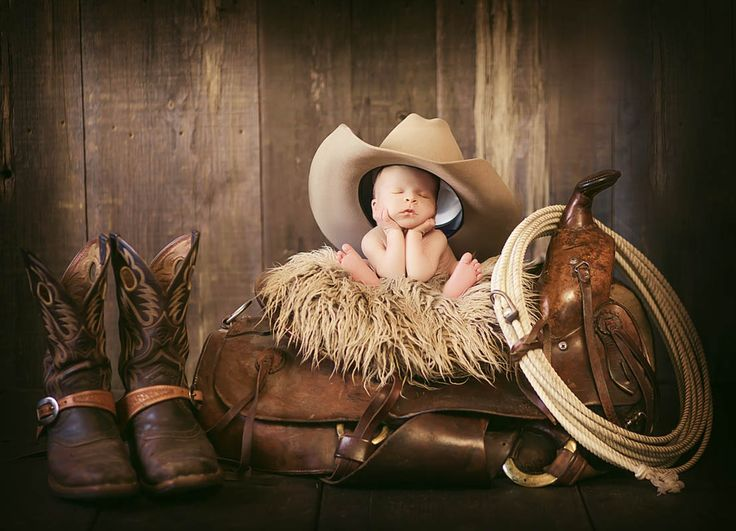 Little cowboy sleeping on saddle