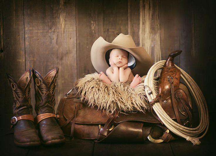Little cowboy sleeping on saddle