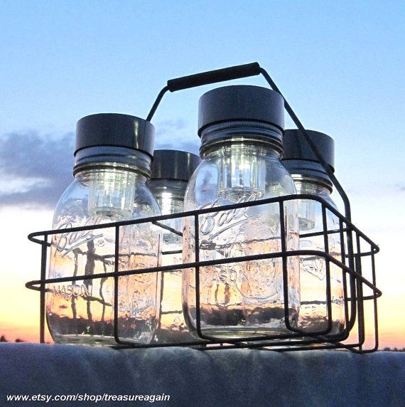 Ball Jars Solar Basket Canning Jars 4 Outdoor Lighting Antique Milk Bottle Carrier Dairy Basket Canning Fruit Jars Mason Jar Solar Lights. $76.00, via Etsy.