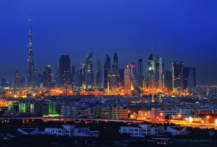 This is a photograph of the forest of skyscrapers in Dubai. The whole emirate is one great building site and features many tall buildings