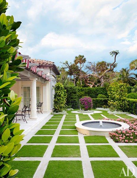 Whether you're relaxing after a match or spectating from the sideline, the tennis pavilion at this beautifully restored Palm Beach mansion is the perfect place to soak up the sun. | archdigest.com