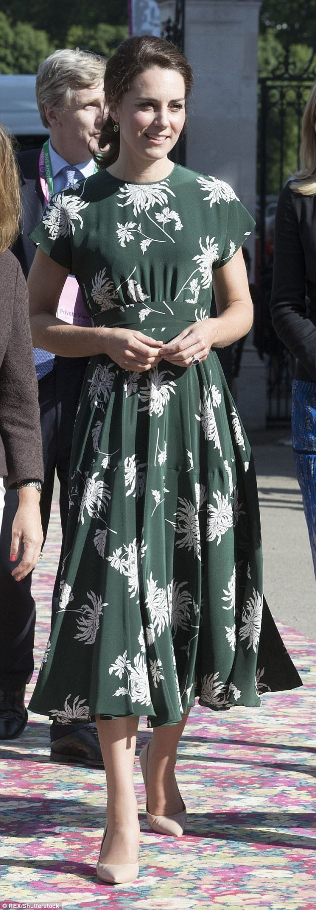 Floral fantasy: There was no mistaking the inspiration behind Kate's choice of outfit for ...