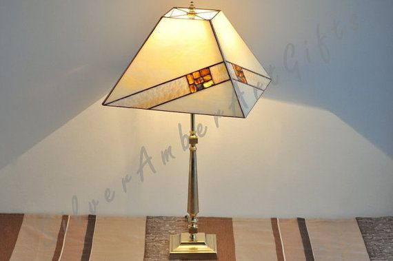 Stained glass table lamp. Tiffany style desk lamp decorated with natural Baltic amber.