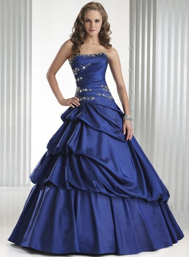 Blue Ball Gown Strapless BeadedTaffeta Prom Dress  Price: 155.98    Full ballgown with dipped neckline and corset closure. This taffeta prom gown features beading cutting through the gently ruched bodice and surrounding the back corset closure. Rich bustling gives the skirt luxurious volume and finishes with a billowing