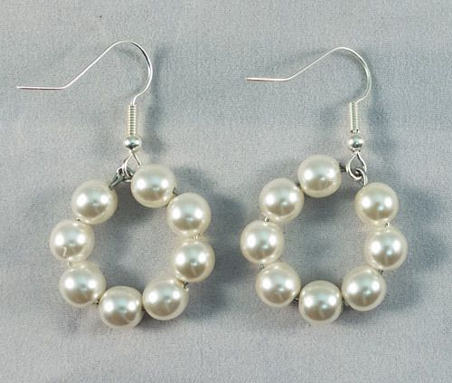 These are beautiful silver, circular earrings made of Majorca pearls. They measure at 2.5 cm.
