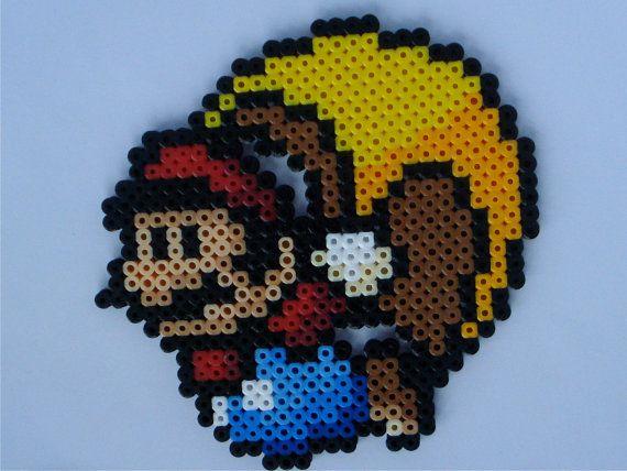 Cape Mario - Super Mario World Perler Bead Sprite Magnet. 8.00, via Etsy.