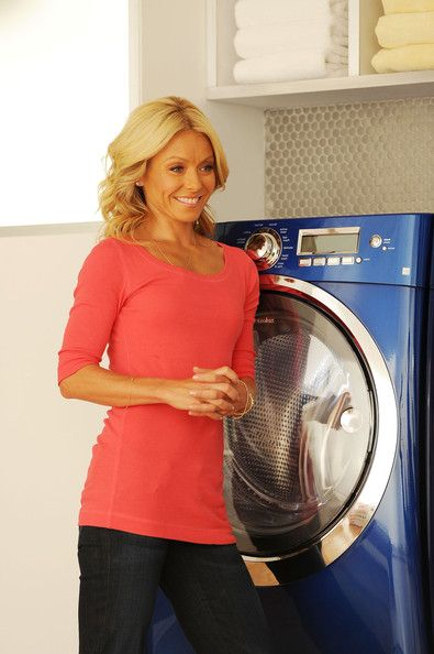 Kelly Ripa Photos Photos - (EXLCUSIVE COVERAGE; PREMIUM RATES APPLY) Television personality Kelly Ripa (pictured) teams up with husband Mark Consuelos to film the latest in a series of popular television commercials for Electrolux Appliances on July 20, 2010 in the borough of Queens in New York City. - Kelly Ripa and Mark Consuelos Get Steamy