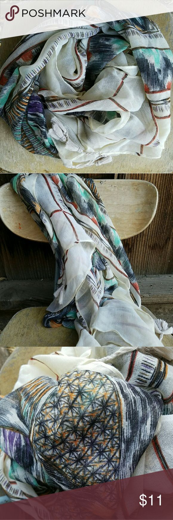 "Tribal print scarf with tassles Another great multicolor scarf that goes great with many different outfits. Tribal print with tan, aqua, brown, purple, and orange. ""Square"" scarf/wrap.  No tags. No Paypal, please. Fee free to make an offer! Accessories Scarves & Wraps"