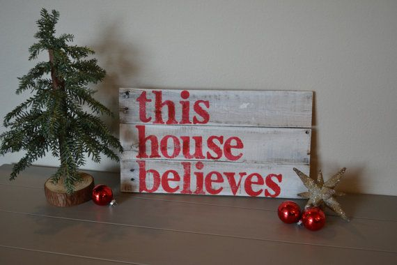 """Our """"this house believes"""" sign would be a perfect addition to your holiday decor this Christmas! by VintageLoveCompany, $20.00"""