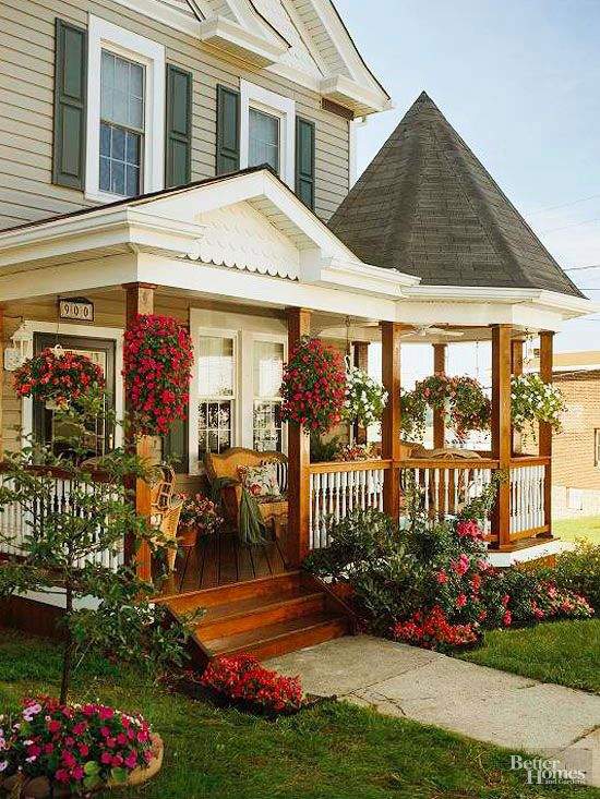 A front porch filled with flowers ramps up curb appeal