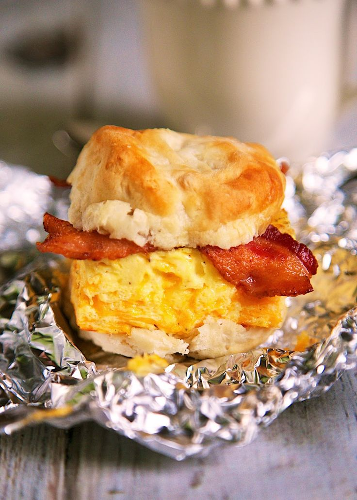 Bacon, Egg & Cheese Biscuit Sandwich Recipe – biscuit topped with a cheesy baked…