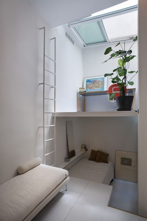 Tiny Madrid apartment by MYCC with rooms connected by ladders