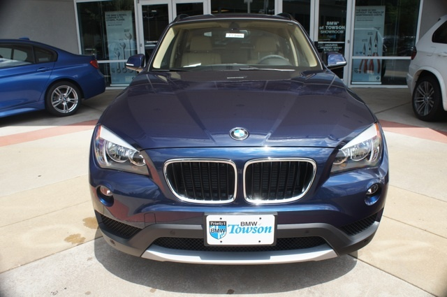 2014 BMW X1 xDrive 28i in Deep Sea Blue. #BMWTOWSON #27108 AWD, Navigation, Heated Front Seats, Auto-Dimming Rear-View Mirror, Comfort Access Keyless Entry, Lumbar Support, Nevada Leather Upholstery, Power Front Seats w/Driver Seat Memory, Rear-View Camera, Light Fineline Wood Trim, and more...