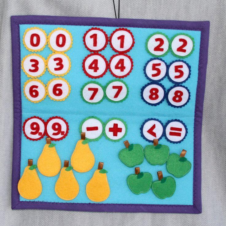 Velcro sviluppo board (libro tranquillo) per bambini in età prescolare. Modo divertente per imparare i vostri piccoli a contare.  Questa scheda particolare non era fatta per un ordine, quindi è pronto per inviare.  Pensione comprende: 1 pz di tavola 30 x 30 cm (11,8 x 11,8 pollici) 2 x 10 numeri da 0 a 9 segni di matematica 4 pz 5 pezzi di mele 5 pezzi di pere  Ogni PC può essere fissato sul bordo da velcro, quindi è perfetto per lunghe in auto.  Spedizione possibile da regolare in base al…