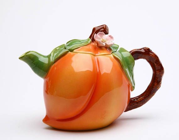"""Peach Teapot Unique design and Hand-Painted by the skilled worker Item# 20834 Product Size: 6 ½"""" x 4"""" x 4 5/8""""H (12 oz) UPC# 752593208348 Ceramic Material Glazed Finish Hand Wash only Made in China"""